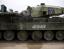 An armoured tank is seen abandoned along a road in Bazza town, after the Nigerian military recaptured it from Boko Haram, in Adamawa state May 10, 2015. REUTERS/Akintunde Akinleye