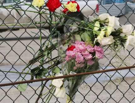 flowers at winsport bobsled track where jordan and evan caldwell died