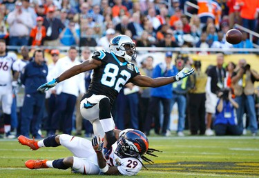 Carolina Panthers' Jerricho Cotchery fails to catch a pass under defensive pressure from Denver Broncos' Bradley Roby (29) in the first quarter of the NFL's Super Bowl 50 football game in Santa Clara, California February 7, 2016. (REUTERS/Mike Blake)