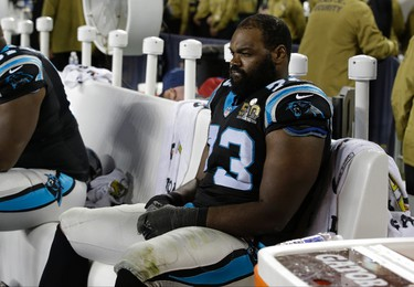 Carolina Panthers' Michael Oher (73) watches from the bench during the second half of the NFL Super Bowl 50 football game Sunday, Feb. 7, 2016, in Santa Clara, Calif. (AP Photo/Marcio Jose Sanchez)