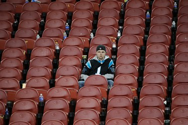 A Carolina Panthers fan sits in the stands after the NFL Super Bowl 50 football game between the Denver Broncos and the Panthers, Sunday, Feb. 7, 2016, in Santa Clara, Calif. The Broncos won 24-10. (AP Photo/Jae C. Hong)