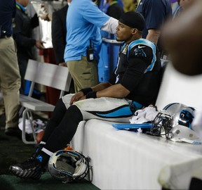 Carolina Panthers' Cam Newton (1) sits on the bench during the second half of the NFL Super Bowl 50 football game against the Denver Broncos Sunday, Feb. 7, 2016, in Santa Clara, Calif. (AP Photo/Marcio Jose Sanchez)