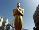 FILE - This Feb. 26, 2012 file photo, shows an Oscar statue on the red carpet before the 84th Academy Awards in Los Angeles. The 88th Academy Awards nominations will be announced on Thursday, Jan. 14, 2016, at 5:30 a.m. PT in the Academy's Samuel Goldwyn Theater in Beverly Hills, Calif. The Oscars will be presented on Feb. 28, 2016, in Los Angeles. (AP Photo/Matt Sayles, File)