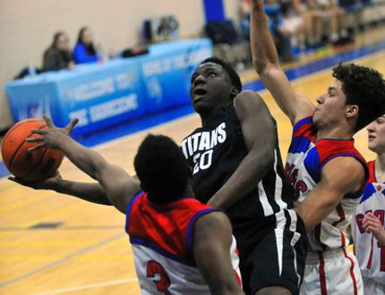 Shyheim Thomas of the Holy Trinity Titans tries to get a shot off while being guarded by Orangeville's Greg Nesbeth and Tyrell Asante during the Simcoe Sabres Shootout Jr. Boys Basketball Tournament final on Saturday. The Titans won the match 37-34. (JACOB ROBINSON Simcoe Reformer)