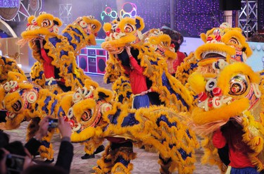 Performers show lion dance in a night parade to celebrate Chinese New Year in Hong Kong Monday, Feb. 8, 2016. The Lunar New Year this year marks the Year of the Monkey in the Chinese calendar. (AP Photo/Vincent Yu)