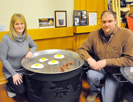 Greg and Tracey McGahey of Norfolk display one of the Muskoka BBQ Fire Pits on sale at the Long Point Area Fish and Game Club Fishing and Hunting Show and Yard Sale on Saturday. (JACOB ROBINSON Simcoe Reformer)