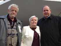 Supporters of the Oasis Program in Kingston on Monday, from left, Brian Brophy, Christine McMillan and Rodger James. (Paul Schliesmann/The Whig-Standard)