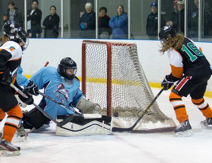 North Park's Rachel Miller tries to score on Assumption goalie Jayden Martin during a high school girls hockey quarter-final game Monday at the Wayne Gretzky Sports Centre. (Brian Thompson/The Expositor)