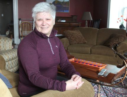 Carole Russell, in her home in Amherstview, is a member of a five-woman group that is sponsoring a Syrian refugee family and bringing them to Canada in the next few weeks. (Michael Lea/The Whig-Standard)