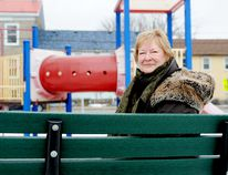 Cathy TeKamp sits on a bench at the Perth Street park the city is renaming after her late husband, former mayor Ben TeKamp, on Sunday in Brockville. (RONALD ZAJAC/The Recorder and Times)