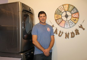 Arik Evers, owner of Mitton Street's Maya's Village Bakery, is starting up a laundry club for people in Mitton Village who don't have access to laundry facilities.  CARL HNATYSHYN/SARNIA THIS WEEK