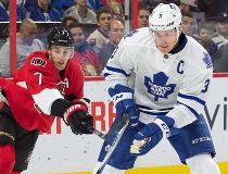 Toronto Maple Leafs defenseman Dion Phaneuf (3) skates with the puck in front of Ottawa Senators center Kyle Turris (7) in the second period at the Canadian Tire Centre. Marc DesRosiers-USA TODAY Sports