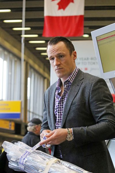 Former Toronto Maple Leaf Dion Phaneuf checks in at the Calgary International Airport enroute to Detroit after being traded to the Ottawa Senators on Feb. 9, 2016 (Gavin Young/Postmedia Network)