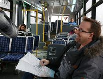 Jason Miller/The Intelligencer Coun. Egerton Boyce speaks to a passenger on the number two bus on Tuesday. The city councillor spent the morning using the transit system to get an understanding of the challenges it faces.