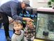 Lansdowne Public student Alastair Park hams it up for his classmates Tuesday as he and fellow student Kennedy Keating show off the classroom salmon aquarium to Bluewater Anglers president Dick Bornais. Chinook salmon are being raised by staff and students at three Sarnia schools through a pilot education initiative organized by the Bluewater Anglers and its hatchery. Barbara Simpson/Sarnia Observer/Postmedia Network