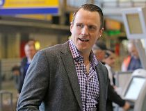 Former Toronto Maple Leaf Dion Phaneuf checks in at the Calgary International Airport en route to Detroit after being traded to the Ottawa Senators on Tuesday February 9, 2016 (Gavin Young/Postmedia)