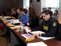 Ontario Provincial Police Const. Roop Sandhu of the Frontenac Detachment takes part in the inaugural Community Risk Watch meeting at Kingson Police headquarters in Kingston on Tuesday. (Ian MacAlpine/The Whig-Standard)