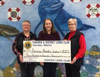 Pictured are Lions Club Members Karin Wilson (left) and Sharon Schlichter (right) presenting a cheque for $375 to Caroline Cleave (centre), Director of Community Services for the Town of Fairview. The donation will go towards Spuds Activity Room at the Fairview Regional Aquatic Centre.