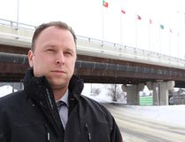 Det.-Const. Ryan Johnson, of the Greater Sudbury Police, stands near the Bridge of Nations where his quick actions may have saved a young woman's life in Sudbury, Ont. on February 8, 2016. John Lappa/Sudbury Star/Postmedia Network