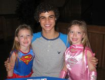 Lynedoch's Kolton Stewart, 16, shares a smile with current St. Frances students Lily and Isabelle Girard. Stewart was on hand to perform at the Princess and Superhero Ball this past Saturday. (JACOB ROBINSON Simcoe Reformer)