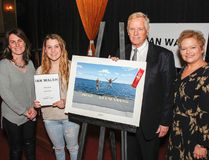 Paige Palmer, second from left, is awarded $700 and has her photo taken with Kingston Life's editor Danielle Vandenbrink and Kingston Accommodation Partners representatives William J Swan and Heather Ford, after her photo was chosen as the overall winner in the Student and Youth Category at the inaugural Ian Walsh Photography Competition award ceremony held in Memorial Hall on Wednesday. (Julia McKay/The Whig-Standard)