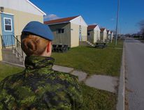 Intelligencer file photo/Luke Hendry A member of the Canadian Armed Forces stands outside the cadet barracks at CFB Trenton. The barracks had been winterized in the fall to house Syrian refugees, but the Canadian government confirmed this week only two bases — Kingston and Valcartier — remains as potential homes for refugees.