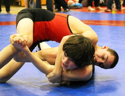 James Crummer of Lambton Central gains top position over St. Clair's Kevin Robertson during a 47.5-kg boy's wrestling match at the LKSSAA championships at SCITS on Thursday February 11, 2016 in Sarnia, Ont. The top four wrestlers in each of the 28 weight classes will advance to SWOSSAA next Thursday at St. Pat's. (Terry Bridge/Sarnia Observer/Postmedia Network)