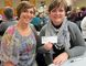 Members of the Norfolk chapter of the 100 Women Who Care write out $100 cheques and donate them to worthy local causes at the end of their quarterly meetings. Among those preparing to do good at the chapter's February meeting this week were Joanne Pond, left, and Jane Drescher, both of Simcoe. (MONTE SONNENBERG Simcoe Reformer)