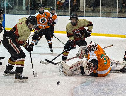 Nathan Robinson of Paris District High School watches a shot by teammate Bailey Pritchard (left) go beyond the reach of North Park Trojans goalie Rich Little for a goal on Thursday during a high school boys semifinal hockey game at the Wayne Gretzky Sports Centre.(Brian Thompson/The Expositor)
