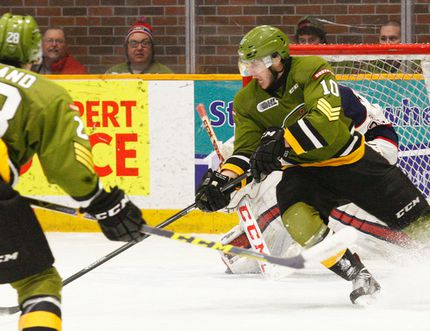 Dave Dale / The Nugget North Bay Battalion Brett Hargrave (10) steals the puck off Saginaw Spirit defenceman Robert Proner (6) before scoring the game-winner in a 4-1 OHL decision at Memorial Gardens, Thursday. Hargrave, of North Bay, scored his second of the game in the third period rushing down the left side from his own blueline to put the contest out of reach for Saginaw.