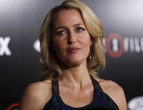 """Cast member Gillian Anderson poses at a premiere for """"The X-Files"""" at California Science Center in Los Angeles, California January 12, 2016. A 6-episode series premieres on January 24. REUTERS/Mario Anzuoni"""