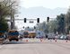 Buses make their way to bring parents waiting to reunite with their children, Friday, Feb. 12, 2016, in Glendale, Ariz., after two teens were shot Friday at Independence High School in the Phoenix suburb. (AP Photo/Matt York)