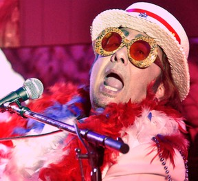 Russeldale native Les Smith entertained more than 220 ladies as Elton John during the Mitchell & District Agricultural Society's Ladies Night, held Feb. 5 at the Crystal Palace. Smith has been impersonating Elton for 15 years, as well as Garth Brooks for 18. ANDY BADER/MITCHELL ADVOCATE