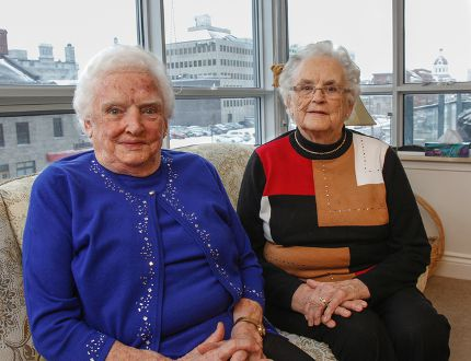 Fraternal twins Lola Gourdier, left, and Lois Halligan, seen here at Gourdier's apartment in Kingston on Tuesday, will celebrate their 90th birthday on Friday, Feb. 19. The sisters were born on Wolfe Island. (Julia McKay/The Whig-Standard)