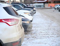 Cars are lined up in a municipal parking space, on the old Diggers lot, in Downtown Fort McMurray Alta. on Thursday February 11, 2016. Garrett Barry/Fort McMurray Today/Postmedia Network