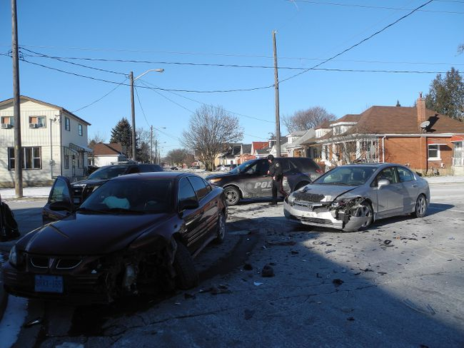 Brantford police officers responded to a two-vehicle collision at Darling and Rawdon streets around 4 p.m. Sunday. (Michael-Allan Marion/Expositor Staff)
