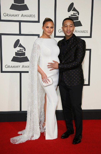 Model Chrissy Teigan and musician John Legend arrive at the 58th Grammy Awards in Los Angeles, California February 15, 2016.  REUTERS/Danny Moloshok