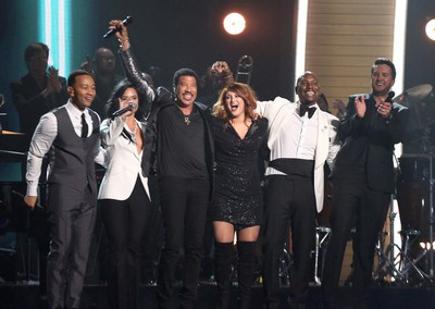 John Legend, from left, Demi Lovato, Lionel Richie, Meghan Trainor, Tyrese, and Luke Bryan perform a tribute to MusiCares Person of the Year honoree Lionel Richie at the 58th annual Grammy Awards on Monday, Feb. 15, 2016, in Los Angeles. (Photo by Matt Sayles/Invision/AP)