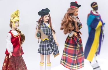 Barbie dolls in various traditional costumes are seen at Barbie Expo, a permanent exhibit that celebrates the best-selling doll's nearly six decades as a fashionista, Friday, February 12, 2016 in Montreal. THE CANADIAN PRESS/Paul Chiasson