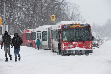 An articulated bus blocks afternoon commuters on Alta Vista Drive after it got stuck in the snow as the region deals with a major snow storm. Assignment - 122909 (Wayne Cuddington)