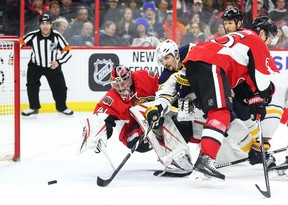 Senators goaltender Craig Anderson follows the puck as Brian Gionta of the Sabres tries to score during second period NHL action at Canadian Tire Centre in Ottawa on Tuesday, Feb. 16, 2016. (Jean Levac/Postmedia Network)