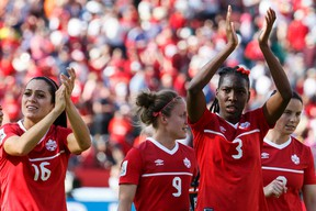 Canada Jonelle Filigno (16), Josée Bélanger (9) and Kadeisha Buchanan (3) salute the crowd after beating China during the second half of a FIFA Women's World Cup 2015 match between Canada and China at Commonwealth Stadium in Edmonton, Alta., on Saturday June 6, 2015. Canada won 1-0. Ian Kucerak/Edmonton Sun/Postmedia Network