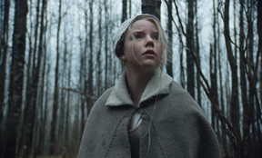"""This photo provided by courtesy of A24 shows Anya Taylor-Joy as Thomasin  in a scene from the film, """"The Witch."""" (Rafy/A24)"""