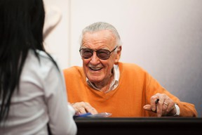 Comic book legend Stan Lee signs autographs at the Marvel booth during day two of the 2015 San Diego Comic-Con International, Friday, July 10, 2015, in San Diego. (Kevin Sullivan/The Orange County Register via AP)
