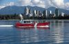 A Canadian Coast Guard vessel is seen on English Bay in Vancouver, B.C., on Tuesday September 22, 2015. THE CANADIAN PRESS/Darryl Dyck