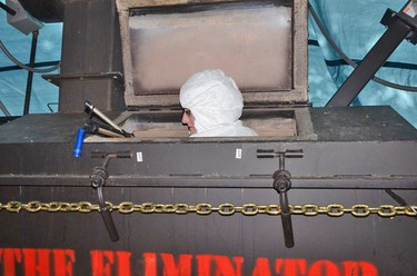 Forensic investigator collects evidence inside the Eliminator incinerator on Dellen Millard's farm in Ayr in this photo shown to the Tim Bosma murder trial.