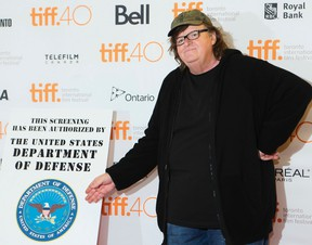 """Michael Moore walks the red carpet at the Princess of Wales Theatre for his premiere of """"Where To Invade"""" ,  during the Toronto International Film Festival in Toronto on Thursday September 10, 2015. Stan Behal/Toronto Sun/Postmedia Network"""