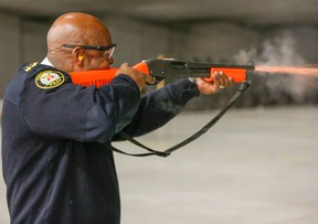 Toronto Police Chief Mark Saunders fires off a new less lethal shotgun that fires sock rounds. Media were invited to the Toronto Police College to see new, less-lethal training police officers are receiving on Friday, Feb. 19, 2016. Dave Thomas/Toronto Sun/Postmedia Network