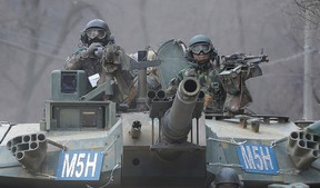 South Korean army soldiers ride a K-1 tank during the annual exercise in Paju, near the border with North Korea, Feb. 19, 2016. (AP Photo/Ahn Young-joon)