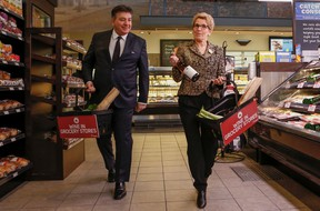 Ontario Premier Kathleen Wynne along with Finance Minister Charles Sousa give an update on wine being sold in grocery stores across Ont. at the Longo's on Laird Dr. in Toronto, Ont. on Thursday February 18, 2016. (Dave Thomas, Postmedia Network)